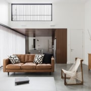 This living area has a high window to floor, furniture, home, interior design, living room, room, white