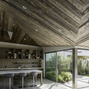 The kitchen is spacious and open, with cabinets architecture, ceiling, daylighting, house, interior design, black, gray