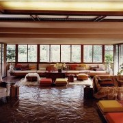 Wright revolved the design of the house around interior design, living room, lobby, real estate, window, wood, red, brown