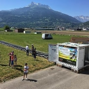 Transportable Solar Microgrid grass, hill station, landscape, mountain, mountain range, outdoor recreation, plant, race, recreation, sky, tree, brown, gray