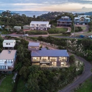 The home sits comfortably on its section - aerial photography, bird's eye view, city, cottage, estate, home, house, neighbourhood, property, real estate, residential area, sky, suburb, tree, urban area, village, black