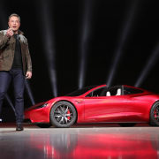 Tesla's new Roadster auto show, automotive design, car, concept car, land vehicle, luxury vehicle, motor vehicle, performance car, personal luxury car, sports car, supercar, vehicle, black