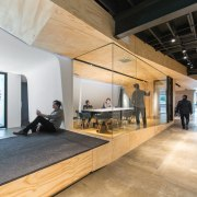 This raised platform makes for a great spot ceiling, floor, flooring, interior design, lobby, loft, wood, orange