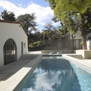 Adjacent to the old house is a large architecture, backyard, estate, home, house, property, real estate, residential area, swimming pool, villa, water, water feature, gray