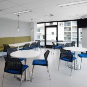 This open dining area faces out to the classroom, interior design, office, table, gray, white