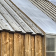 Photo: Pasi Aalto / pasiaalto - Detail of architecture, daylighting, facade, home, house, roof, shed, siding, sky, window, wood, gray