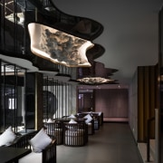 The rock formations sit above this seating area ceiling, interior design, lobby, black