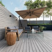 The deck timber runs up and forms the architecture, deck, floor, hardwood, house, outdoor furniture, outdoor structure, roof, sunlounger, wood, gray