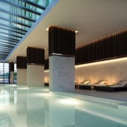 A communal pool features an expansive skylight - architecture, condominium, daylighting, estate, interior design, lighting, lobby, property, real estate, gray