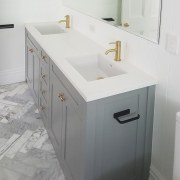 A marble border in the shower floor is bathroom, bathroom accessory, bathroom cabinet, bathroom sink, floor, plumbing fixture, room, sink, tap, tile, white, gray