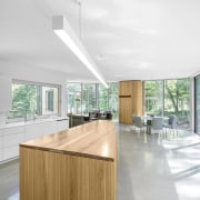 House on lakefront site by  Paul Bernier architecture, ceiling, countertop, daylighting, floor, flooring, furniture, house, interior design, kitchen, product design, real estate, table, white