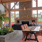 The barn like structure results in a large estate, home, interior design, living room, outdoor structure, patio, real estate, window, gray