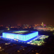 The 70,000 m² National Aquatics Center in Beijing architecture, city, cityscape, downtown, landmark, metropolis, metropolitan area, night, sky, skyline, sport venue, structure, tourist attraction, urban area, black