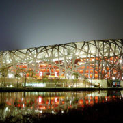 Beijing National Stadium by Herzog de Meuron, ArupSport architecture, convention center, lighting, mixed use, night, opera house, reflection, sport venue, stadium, structure, brown, black