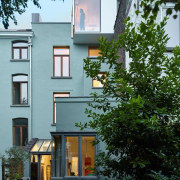 Besides providing an intimate outdoor area, the new architecture, building, cottage, facade, home, house, neighbourhood, property, real estate, residential area, window, gray