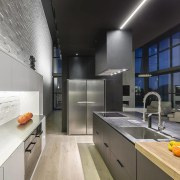 This form was brought into the kitchen by countertop, interior design, kitchen, gray, black
