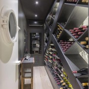 An elegant impressive wine storage area. - Robin interior design, gray, black