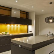 JAG Kitchens - Earth, fire, water and air cabinetry, countertop, interior design, kitchen, lighting, under cabinet lighting, brown, black