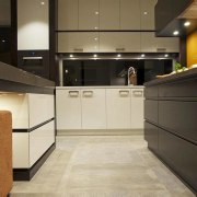 JAG Kitchens - Earth, fire, water and air cabinetry, countertop, floor, flooring, interior design, kitchen, lobby, under cabinet lighting, black, orange