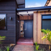 Home entrance - Waitoki family home 04 - architecture, backyard, door, facade, home, house, property, real estate, residential area, siding, window, blue