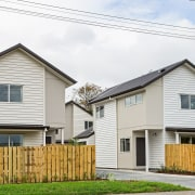Eight new homes in the Richardson-Howell development, owned building, cottage, facade, farmhouse, home, house, neighbourhood, property, real estate, residential area, siding, suburb, white