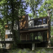 The home sited in an idyllic forest setting architecture, building, cottage, home, house, property, real estate, tree, brown, black