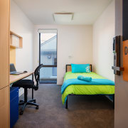 The new Otago Polytechnic student building offers a architecture, bedroom, dormitory, furniture, home, hostel, house, interior design, real estate, room, gray, brown