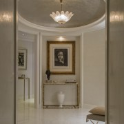 A gorgeous hanging light draws the eye - ceiling, floor, flooring, interior design, light fixture, lighting, lobby, molding, plaster, wall, gray, brown