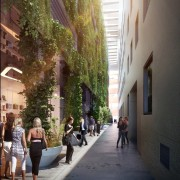 This green wall certainly helps to create an alley, building, city, downtown, infrastructure, neighbourhood, pedestrian, road, street, town, tree, urban area, brown, black