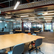 Studio spaces are positioned at the outer edges architecture, interior design, office, real estate, table, black