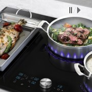 Samsung's Innovative Virtual Flame Technology provides perfect cooking cookware and bakeware, cuisine, dish, food, lunch, meal, white, black