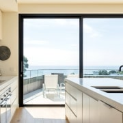 Most rooms capture breathtaking sea views architecture, countertop, daylighting, house, interior design, kitchen, property, real estate, window, white