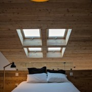This skylight sits over the master bedroom - architecture, bed, bed frame, bedroom, ceiling, daylighting, floor, home, house, interior design, lighting, room, suite, wall, wood, brown
