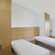 With sustainability and passive design rising high in architecture, bed frame, bedroom, floor, interior design, property, real estate, room, suite, wall, wood, gray, brown