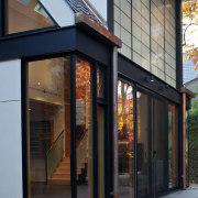 Photo by Jim Tetro - Floor to ceiling door, facade, house, window, black, gray