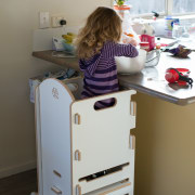 The Arc Assistant assists toddlers to stand up chest of drawers, desk, drawer, filing cabinet, furniture, product, product design, room, shelf, shelving, table, gray