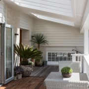 A sheltered outdoor room is a great place ceiling, daylighting, deck, floor, hardwood, home, house, interior design, laminate flooring, living room, outdoor structure, patio, porch, real estate, roof, siding, window, gray