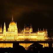 Parliament provides a light show at night - city, cityscape, darkness, landmark, lighting, metropolis, night, reflection, sky, skyline, tourist attraction, black