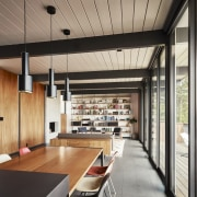 Pendant lights run along the dining table - ceiling, interior design, gray