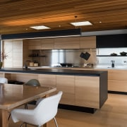 The warmth of wood meets the cool of countertop, cuisine classique, interior design, kitchen, brown