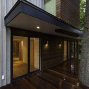 The deck openings are all sheltered - The architecture, deck, facade, floor, home, house, lighting, real estate, siding, window, wood, wood flooring, black