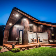 Extensive use of timber create a log cabin architecture, cottage, estate, facade, home, house, property, real estate, blue