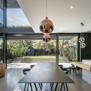The use of quality materials in a minimalist architecture, home, house, interior design, real estate, table, gray