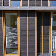 With sustainability and passive design rising high in door, facade, house, siding, window, gray, black