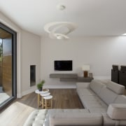 An open living area features an eye-catching centrepiece architecture, ceiling, daylighting, estate, home, house, interior design, living room, property, real estate, room, gray