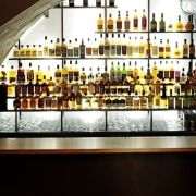 This new whiskey bar takes advantage of a alcoholic beverage, bar, distilled beverage, drink, liquor store, whisky, black