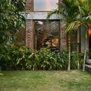 Architect: Studio PKA http://www.purankumar.com/Photographer: Amit Pasricha arecales, backyard, cottage, courtyard, home, house, outdoor structure, palm tree, plant, property, real estate, yard, brown