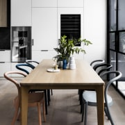 Architect: Technē Architecture + Interior DesignPhotography by chair, dining room, furniture, interior design, product design, table, white