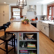 By choosing not to hide the extractor, the cabinetry, countertop, cuisine classique, floor, flooring, hardwood, interior design, kitchen, laminate flooring, room, wood flooring, gray
