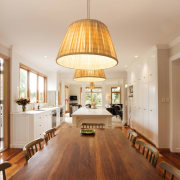 TIDA NZ 2017 – Designer kitchen entrant – ceiling, chandelier, dining room, floor, flooring, hardwood, interior design, laminate flooring, light fixture, lighting, living room, table, wood, wood flooring, orange, brown